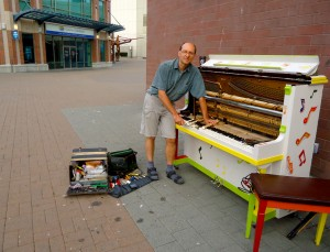 Jurgen Goering repairs Nanaimo's Public Piano